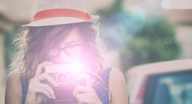 Flash Photography with woman using a retro camera
