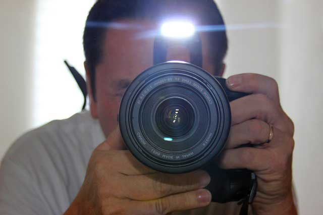 Flash Photography - man taking flash photo