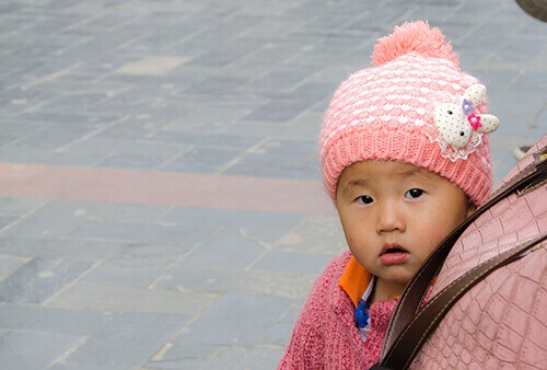 photo of a baby on a street