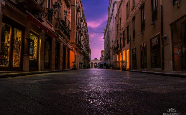 Sunrise at street in Trapani, Sicily (Italy) by Tommie Hansen