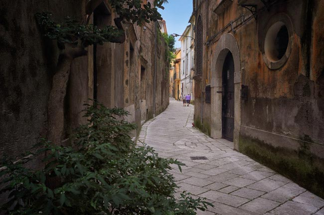 Two Old Ladies Walking down the street in Sant'Agata de' Goti, Italy by Diana Robinson