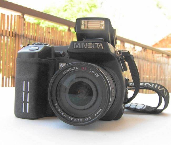 MINOLTA DIGITAL CAMERA with a pop-up Flash by Brian Eager