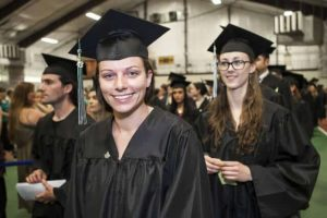 graduate smiling during ceremony