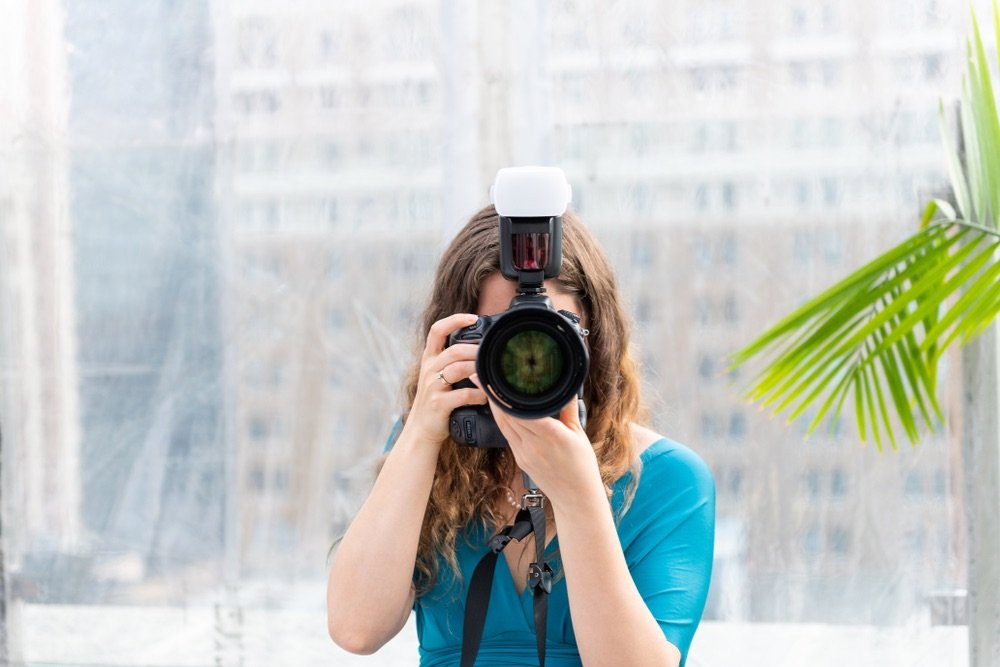photographer using attached external flash.